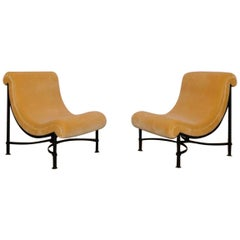 Pair of Large Curved Upholstered Lounge Chairs on Black Metal Bases