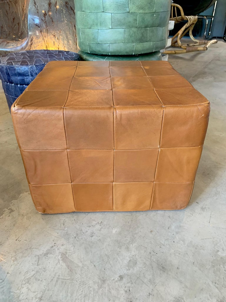 Pair of large patchwork leather ottomans by De Sede in camel. Patchwork leather with great coloring and patina to leather. Very good condition. Great accent piece. 