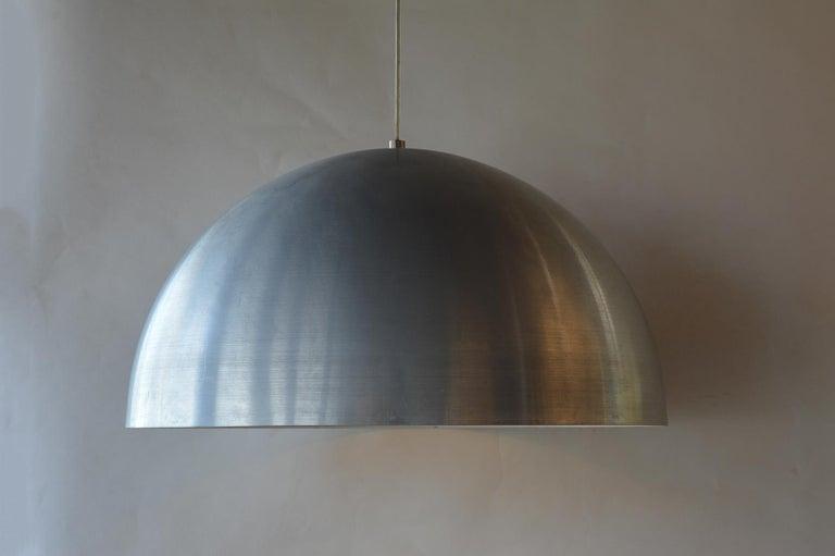 Two brushed aluminum pendant lights.