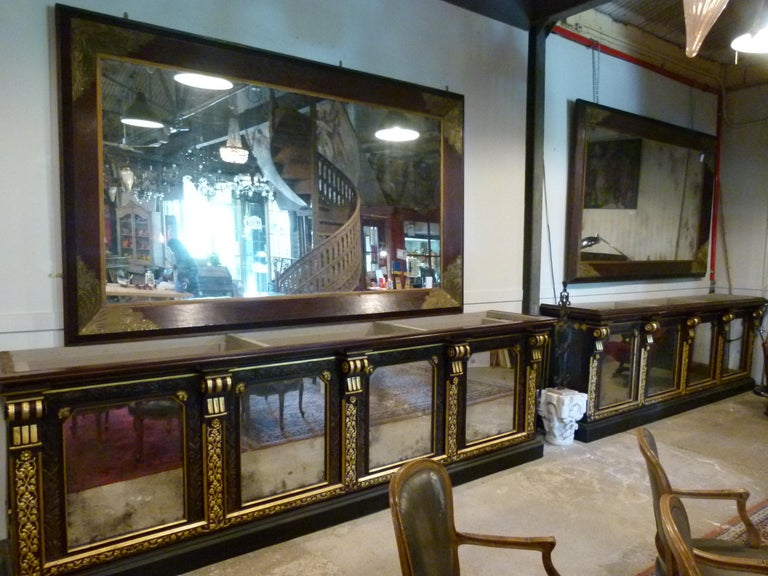 Pair of large early 20th century wall mirrors with wooden frame. Measurements with frame: 283 x 174 cm.