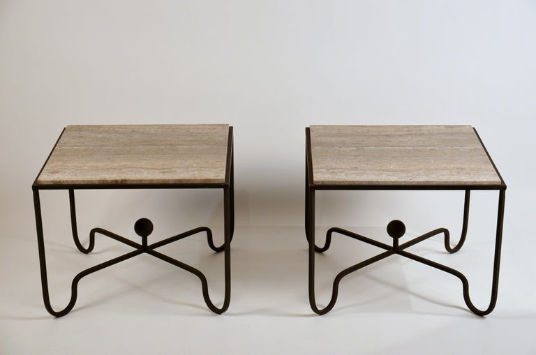 Pair of large 'Entretoise' silver travertine side tables by Design Frères.  Great as sofa end tables or as a 2 part coffee table.  Chic linear veined silver travertine tops over matte black wrought iron bases.