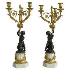 Pair of Large French Figural Candelabra in Patinated Bronze, Ormolu and White Ma