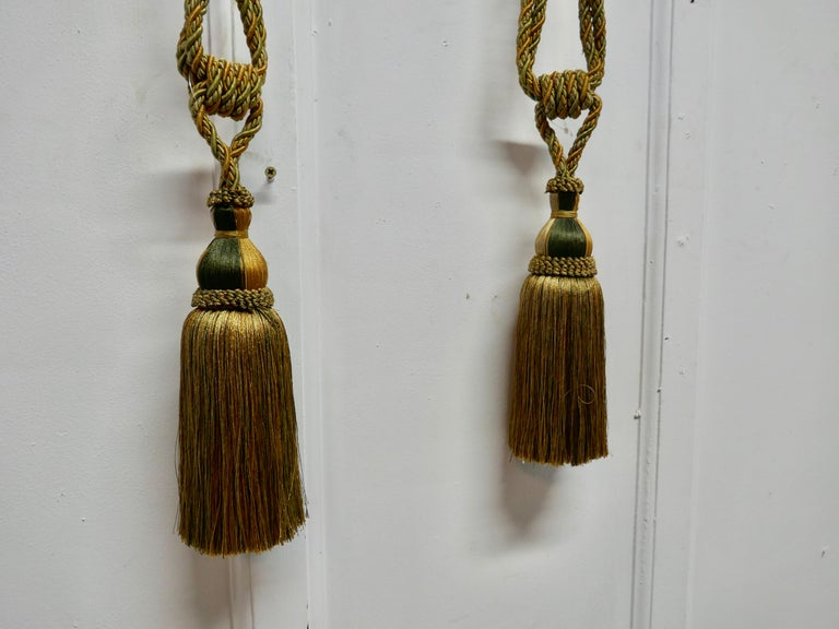 A beautiful pair of large French gold silk handmade tassels, Passementerie curtain tiebacks  Stunning pair of large 19th century French tiebacks, woven in gold silk with a hint of green and brown  The tassels are in good used condition, they are