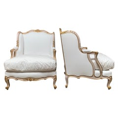 Pair of Large French Louis XV Style Bergeres with a Pink and Gilt Finish