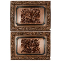 Pair of Large Full-Relief Carved Black Forest Walnut Plaques