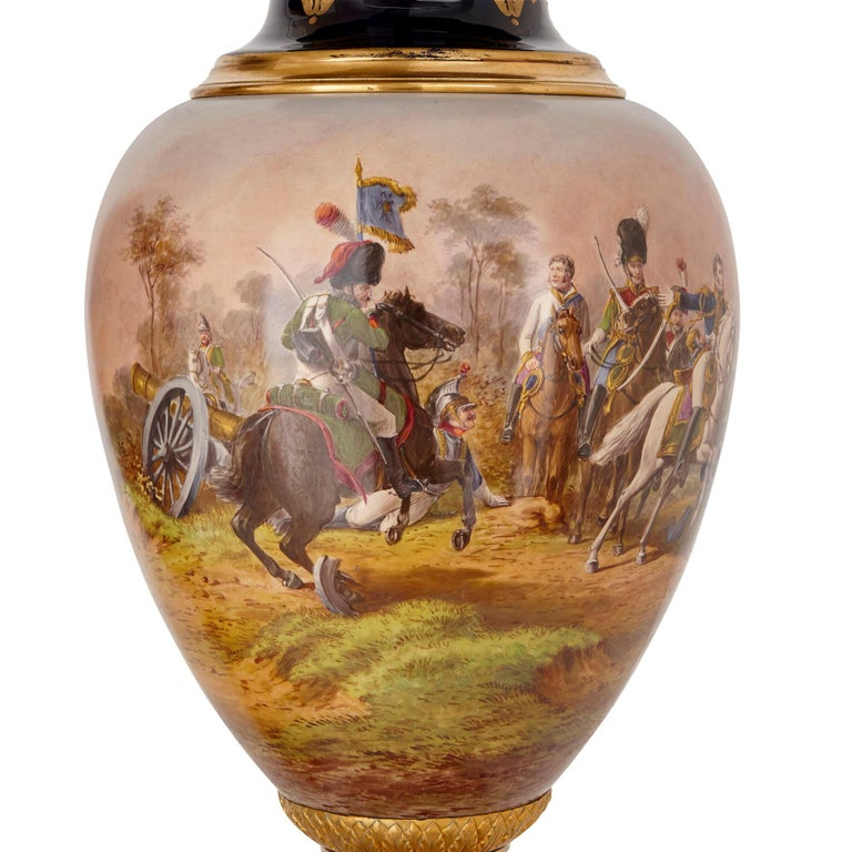 These magnificent vases are crafted from porcelain and measure an impressive 1m (39 inches) in height. Designed in the style of Sèvres porcelain, the vases have been beautifully hand painted with battle scenes from the Napoleonic Wars.   The vases