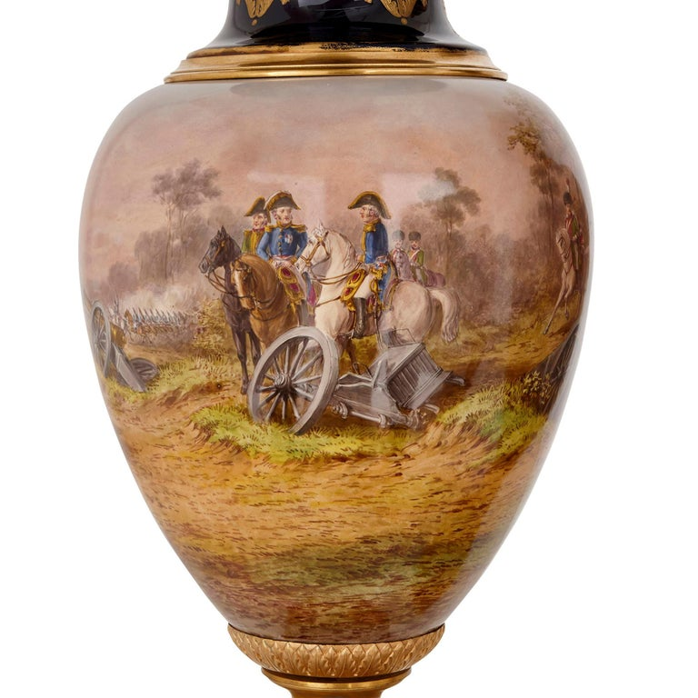 Empire Pair of Large Gilt Bronze and Porcelain Vases with Napoleonic Battle Scenes For Sale