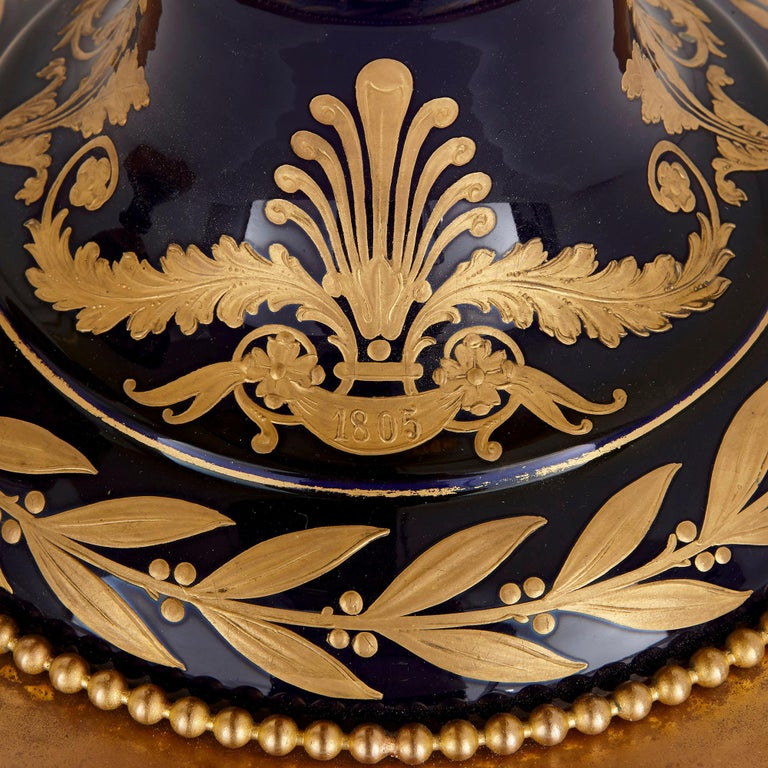 Pair of Large Gilt Bronze and Porcelain Vases with Napoleonic Battle Scenes In Good Condition For Sale In London, GB