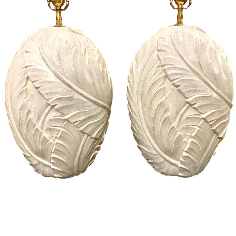 A pair of large circa 1960s French glazed plaster table lamps leaf motif in relief.  Measurements: Height of body 17