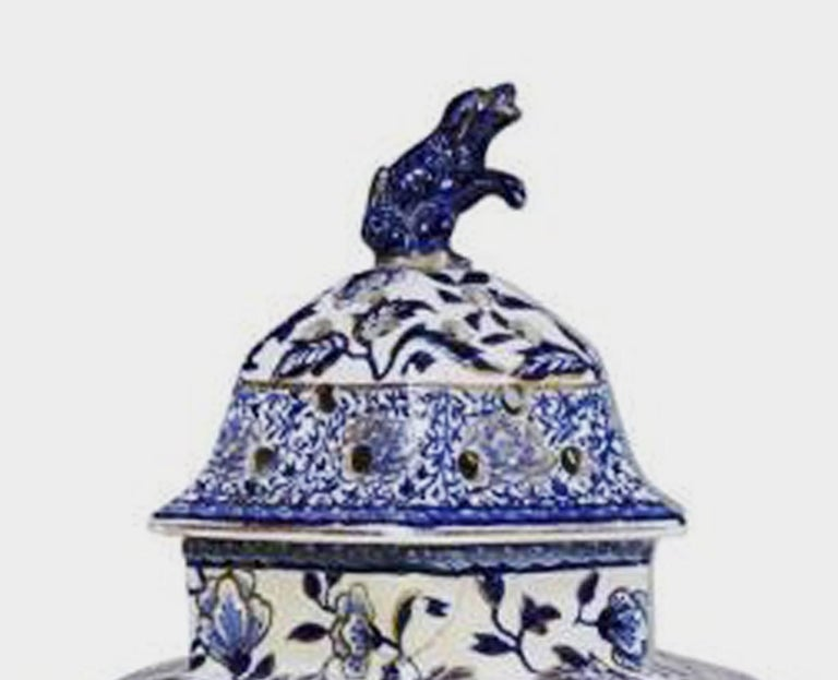 Pair of large hexagonal ironstone vases and covers, Mason's Ironstone or Ashworth, circa 1845.  A pair of large blue and white hexagonal ironstone potpourri vases and covers finely decorated with underglaze blue flowering branches with peony