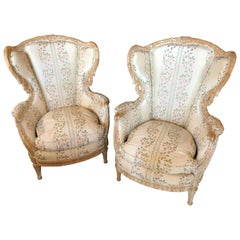 Pair of Large Impressive High Back Distressed Carved Framed Wing Back Armchairs