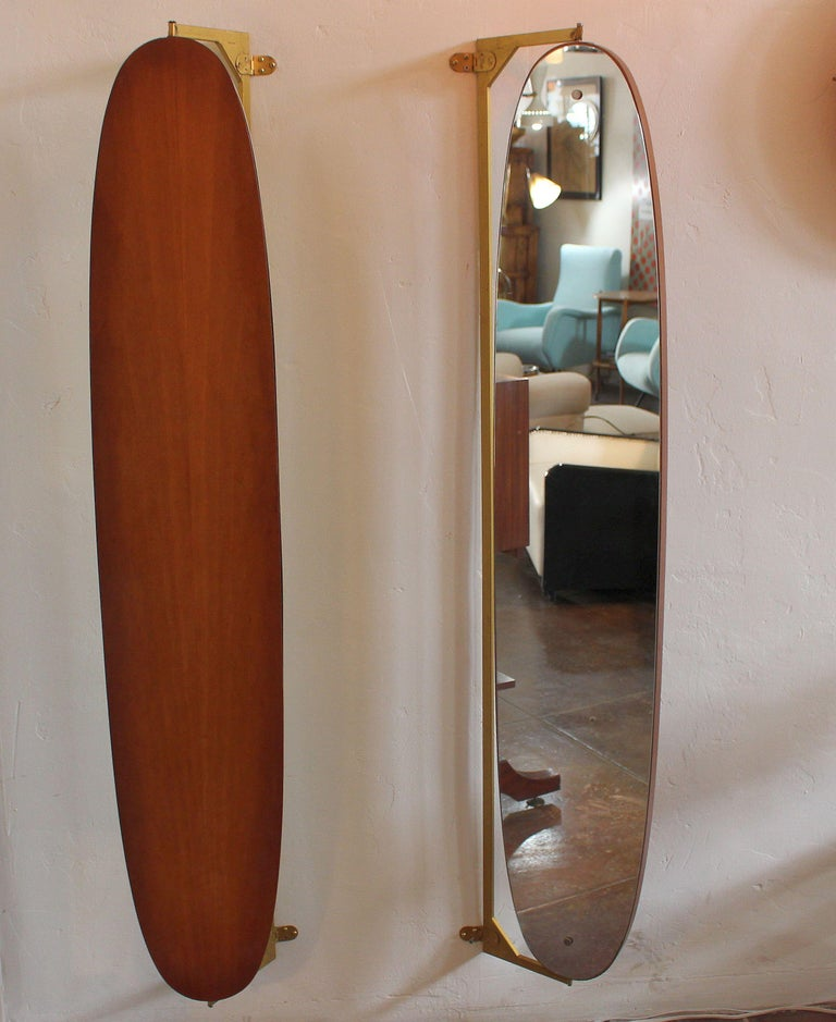 Venetian wall mirrors. Original 1950s oval shape and 360 degrees pivoting mirrors. Base is metal and the fruit wood.