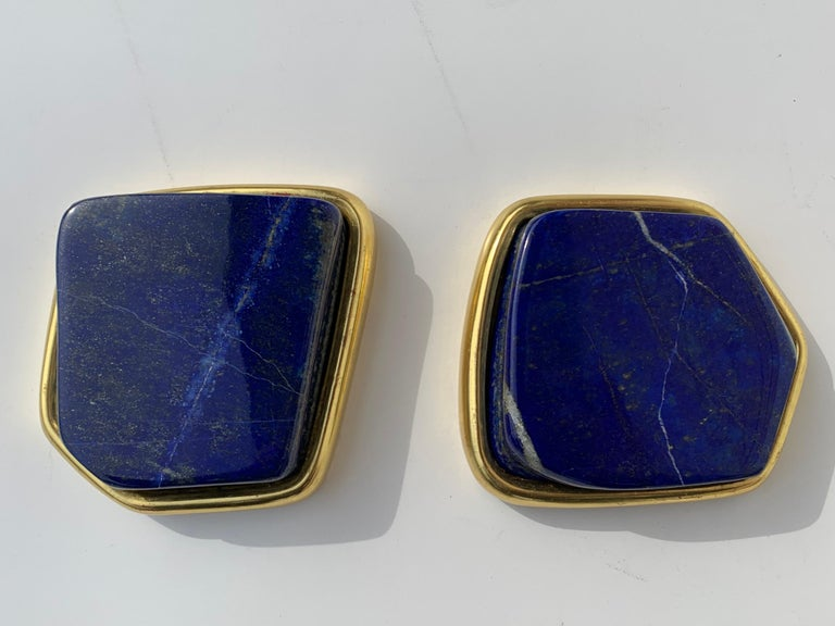 Pair of large Lapis Lazuli decorative paperweights in 22-karat gold leaf setting.