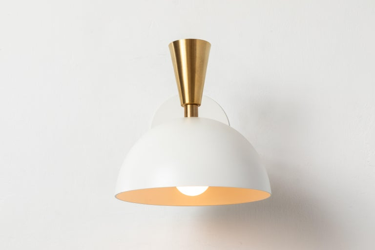 Pair of large 'Lola II' sconces in white metal and brass. Hand-fabricated by Los Angeles based designer and lighting professional Alvaro Benitez, these highly refined sconces are reminiscent of the iconic midcentury Italian designs of Arteluce and