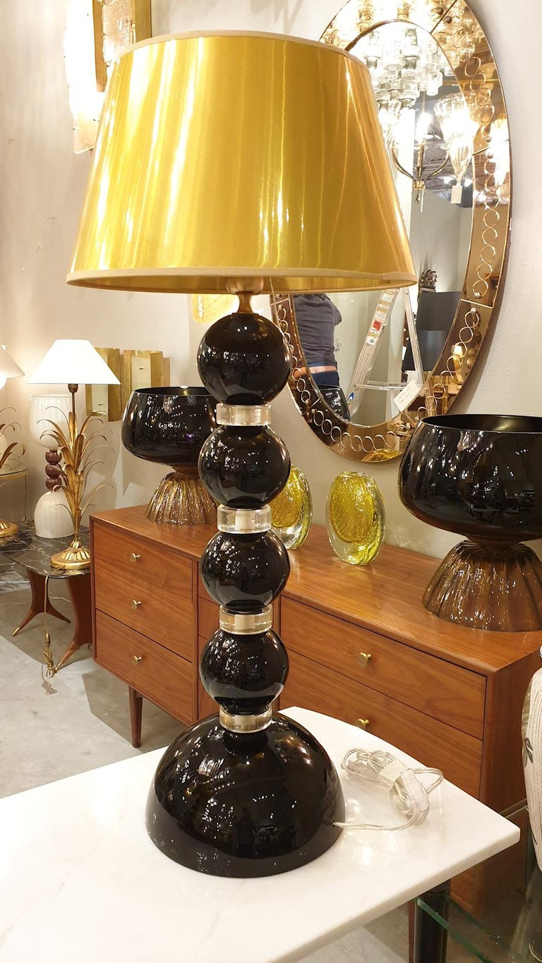 Pair of large opaque black and translucent gold Murano glass, Mid-Century Modern table lamps. Murano, Italy, 1970s Sold with new gold color shades. 1 light each, rewired for the US. Classic with a modern touch.