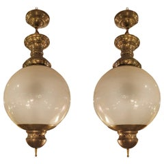Pair of Large Mid-Century Modern Brass and Glass Chandeliers by Dominioni, 1960s