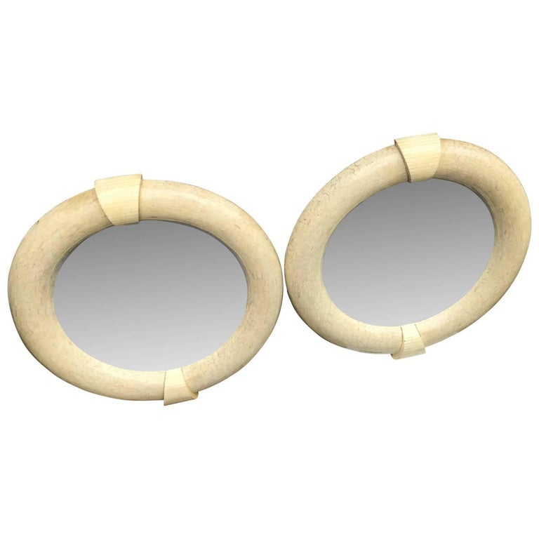 Pair Of Large  Mid-Century Modern Karl Springer Tessellated Round Wall Mirrors  Very rare pair of large Mid-Century Modern mirrors, spanning 48 inches wide and 51.5 inches tall. The four keystones are tessellated in plain vintage white bone and the