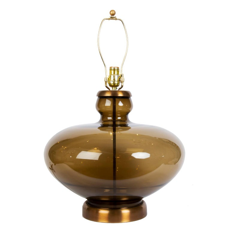 These gorgeous large exotic urn shaped vintage smoked glass lamps with an antique brass metal base and cap are fitted with new shades (optional) and a dimmer switch.