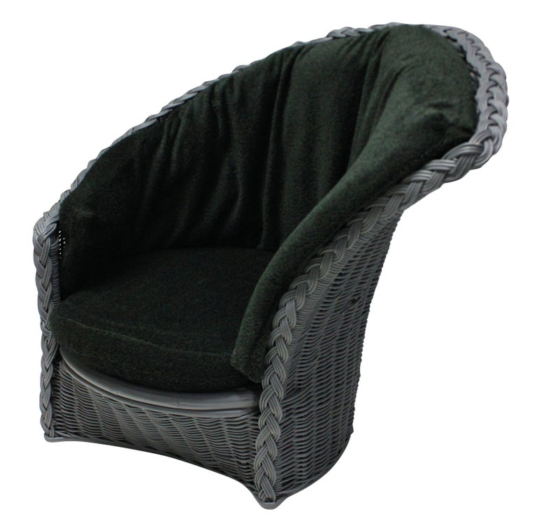 A pair of Italian lounge chairs of good comfortable scale, in grey rattan with mohair cushions in dark green.