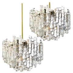 Pair of Large Modern Three-Tiered Brass Ice Glass Chandeliers by J.T. Kalmar