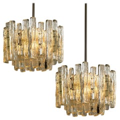 Pair of Large Modern Three-Tiered Chrome Ice Glass Chandeliers by J.T. Kalmar