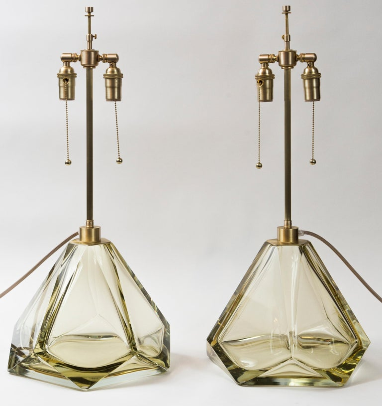 Modern Artisan blown glass and polished diamond faceted lamps in a stunning citrine color. Note these are glass enclosed at the base Electrified to US code with satin brass hardware Dating: new, commissioned artisan work Origin: Murano,