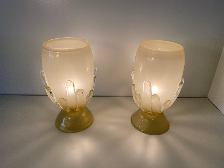 This fine pair of glass lamps were produced in Murano in the early 2000s. They are entirely in glass with a spectacular iridescent color. Perfect conditions.