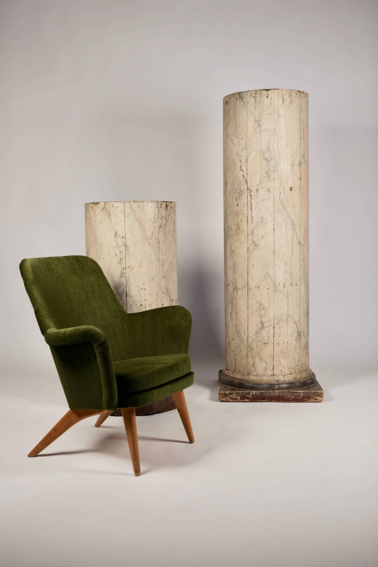 A pair of exceptional large North Italian wood columns North-Italy early 19th century Poli chrome marbled with great patina Measures: The larger 60cm x 60cm base.50cm Ø, 171cm high The smaller 55cm x 55cm base.50cm Ø, 110cm high.