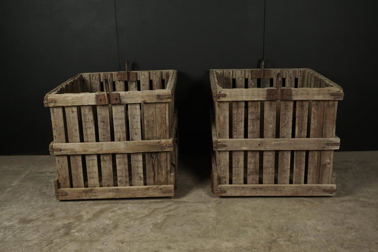 Large pair of oak crates from France, circa 1940. Solid construction with iron detail. Would make fantastic large planters. Presumably from a shipyard.