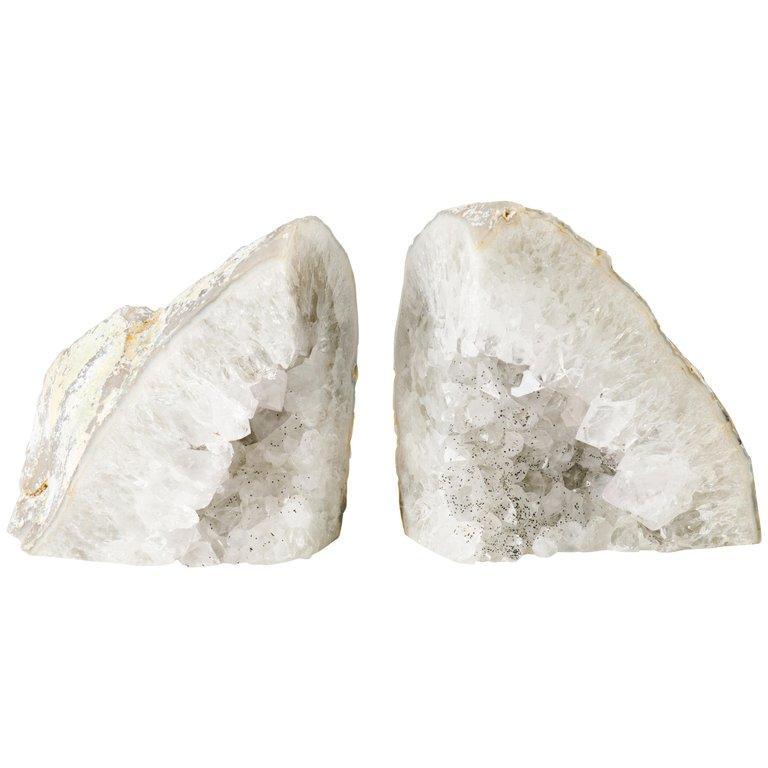 Pair of natural quartz crystal specimens with polished fronts and gorgeous rock crystal centers. The bookends have varying hues of white and silver and feature black speckled centers. Stunning from all angles and completely different looking
