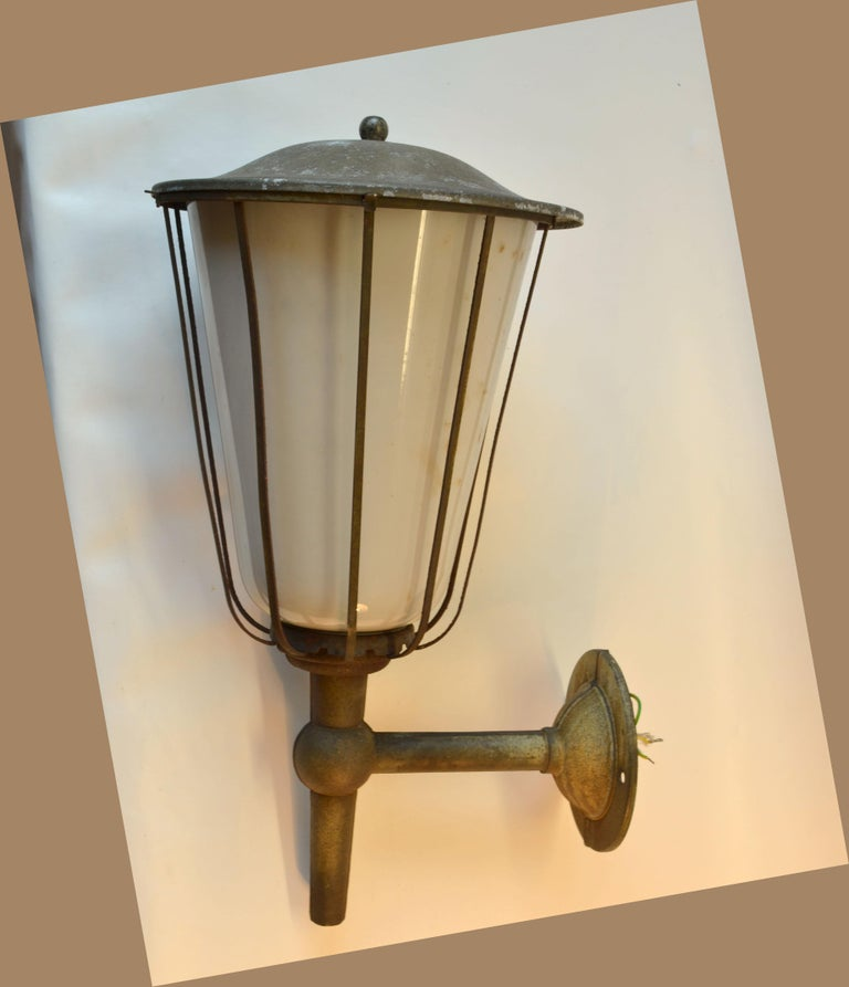 Pair of large outdoor lanterns in zinc plated metal and white glass are early 20th century French. The plating has a nice original patina. They originated from a castle to the south of Germany near Stuttgart and will make a real statement in- or