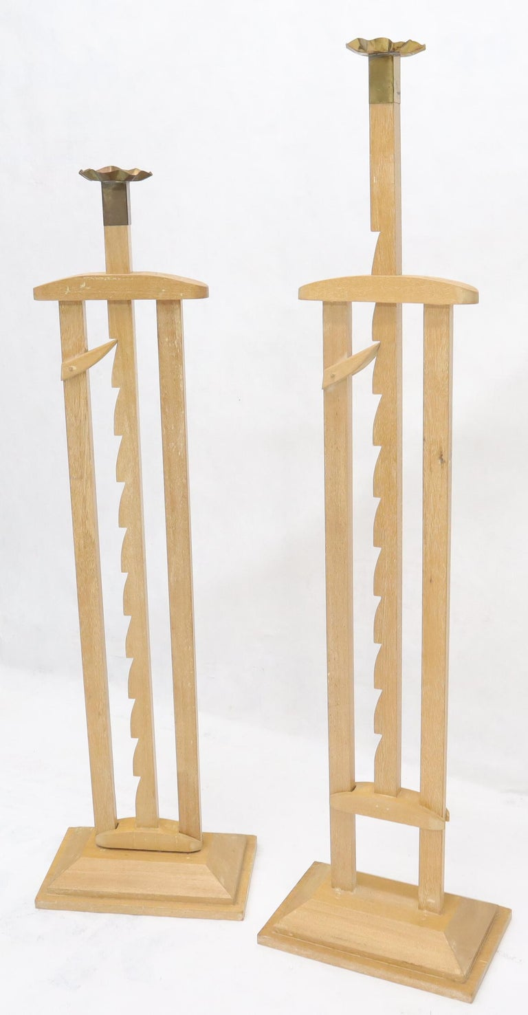 Pair of large adjustable candle sticks.