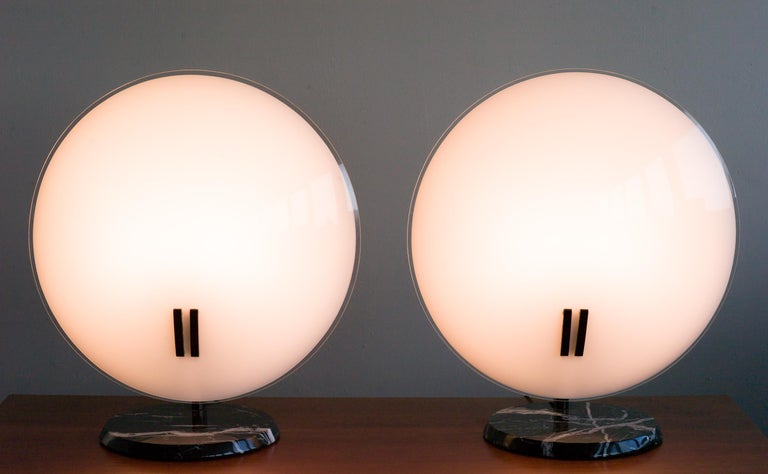 Pair of very large glass table lamps with black marble base model Perla, designed by Bruno Gecchelin for O Luce.  Original wiring, four E26/27 medium base sockets, 100W max. Each lamp can be regulated with a dimmer.  Marked with label. Priced as a