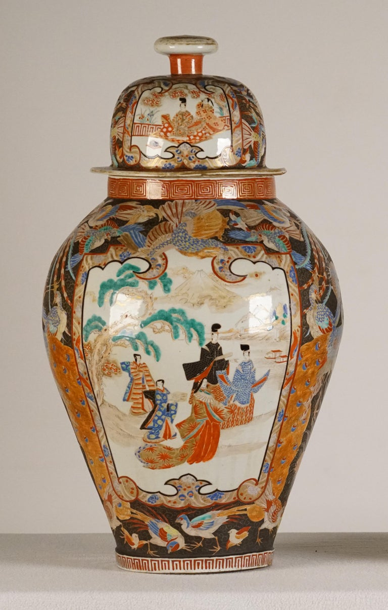 A Pair of Large Porcelain Vases Kutani Period Japan, Circa 1830  The covered baluster vases decorated in polychrome enamels and gilt over a clear glaze with panels of courtiers, the surrounding areas painted with various birds, the neck and foot