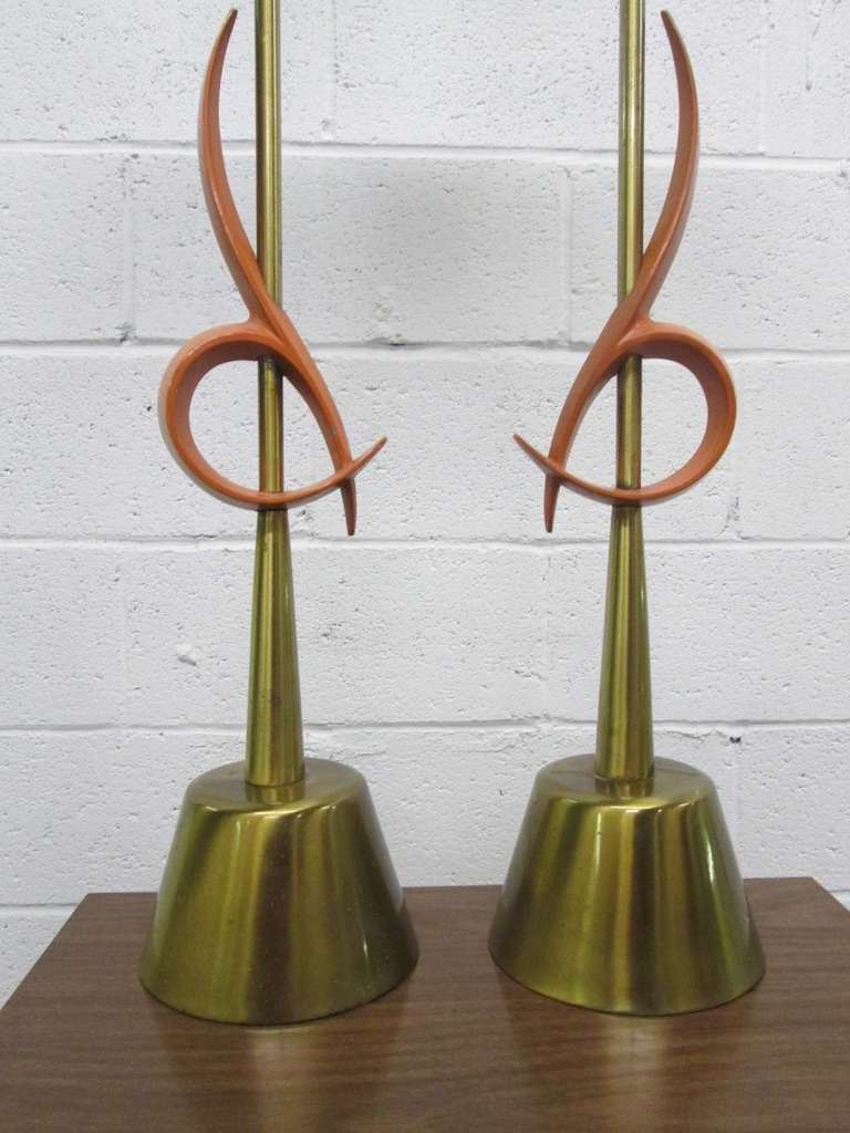 Pair of large Rembrandt table lamps with an orange abstract pattern and round brass base.