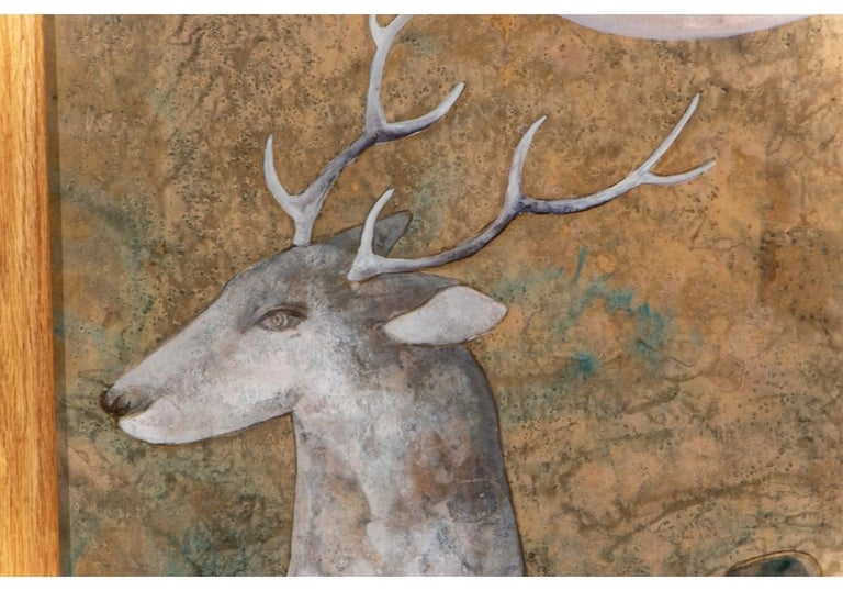 """Serene pair of watercolors and gouaches on paper illustrating stags with saddles, under a full moon. The backgrounds and moons in mottled tones. Signed with calligraphic marks/ signatures. Custom oak frames 62"""" x 31"""