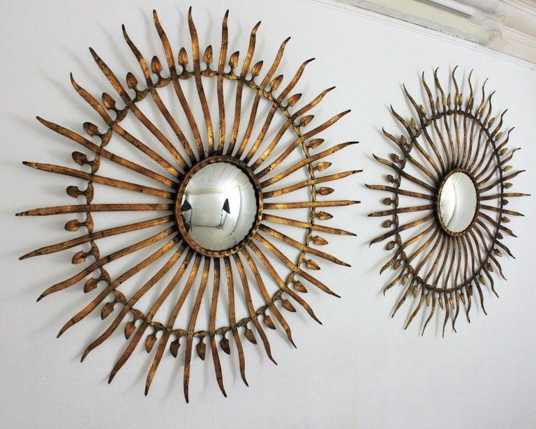 Mid-Century Modern Pair of Sunburst Starburst Gilt Iron Convex Mirrors in Large Scale For Sale