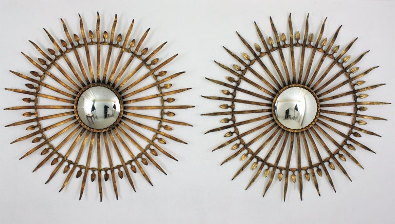 Metal Pair of Sunburst Starburst Gilt Iron Convex Mirrors in Large Scale For Sale