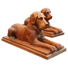 Pair of Large Scale Swiss Black Forest Carved Couchant Hunting Dogs