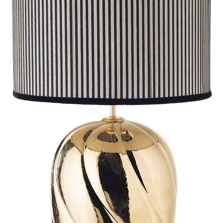 Pair of large ceramic table lamps and shades.