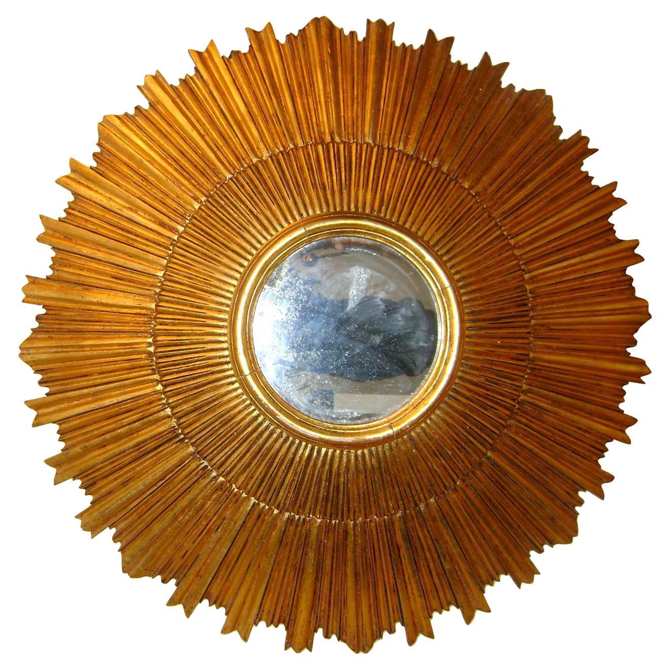 Pair of Large Sunburst Giltwood Mirrors