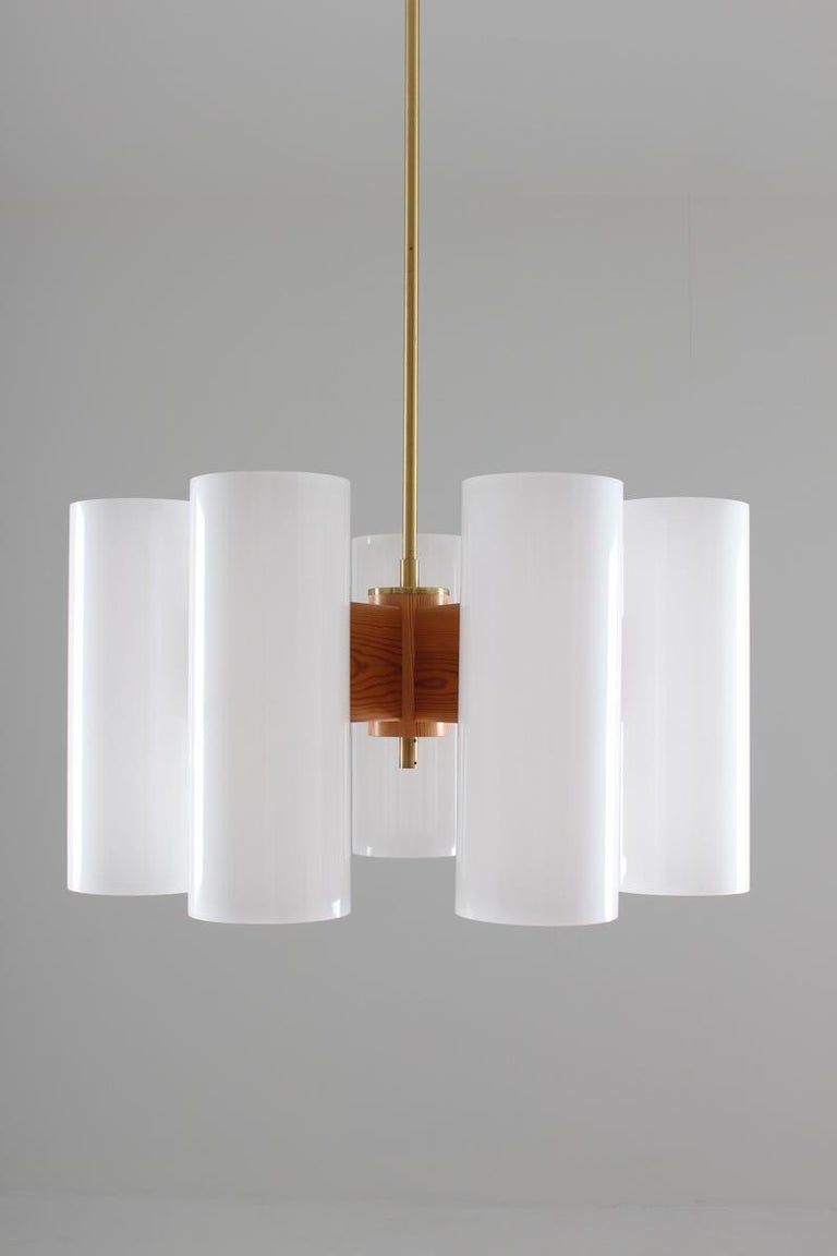 Mid-Century Modern Pair of Large Swedish Midcentury Chandeliers in Acrylic, Pine and Brass by Luxus For Sale