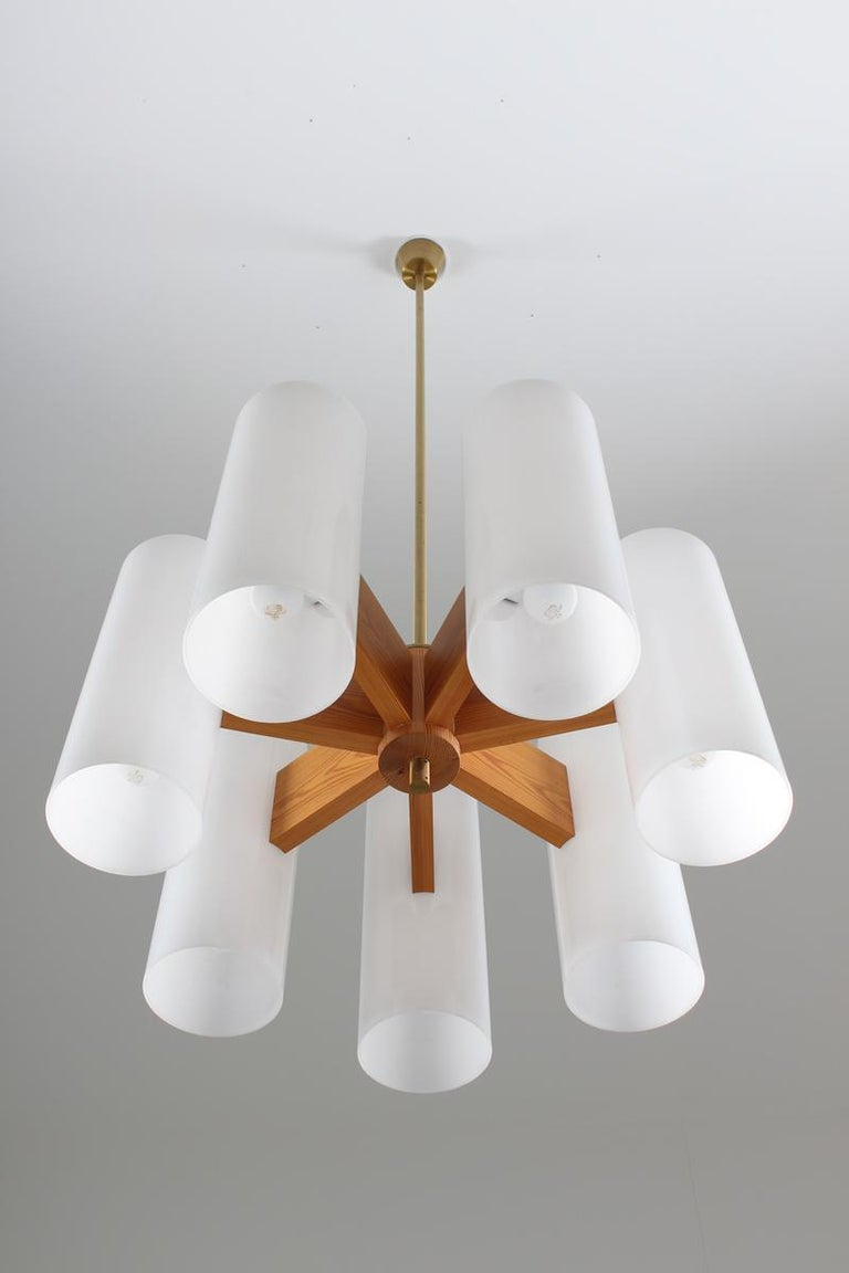 20th Century Pair of Large Swedish Midcentury Chandeliers in Acrylic, Pine and Brass by Luxus For Sale