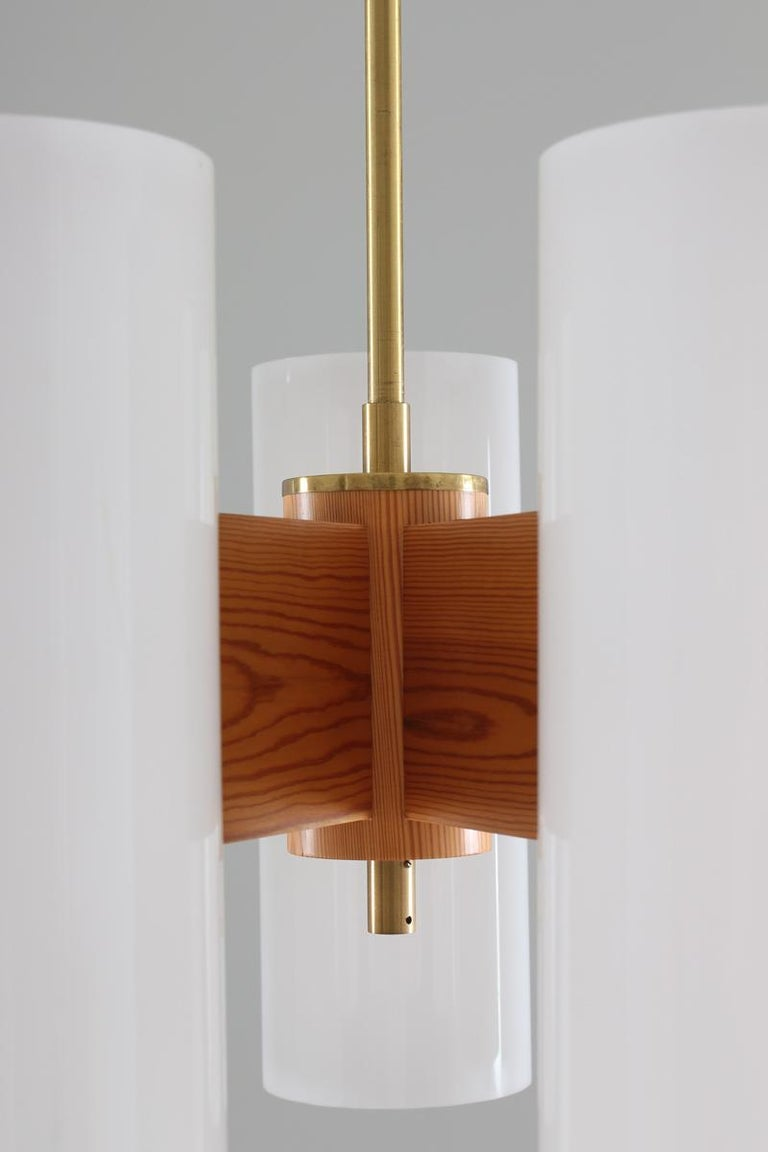 Pair of Large Swedish Midcentury Chandeliers in Acrylic, Pine and Brass by Luxus For Sale 3