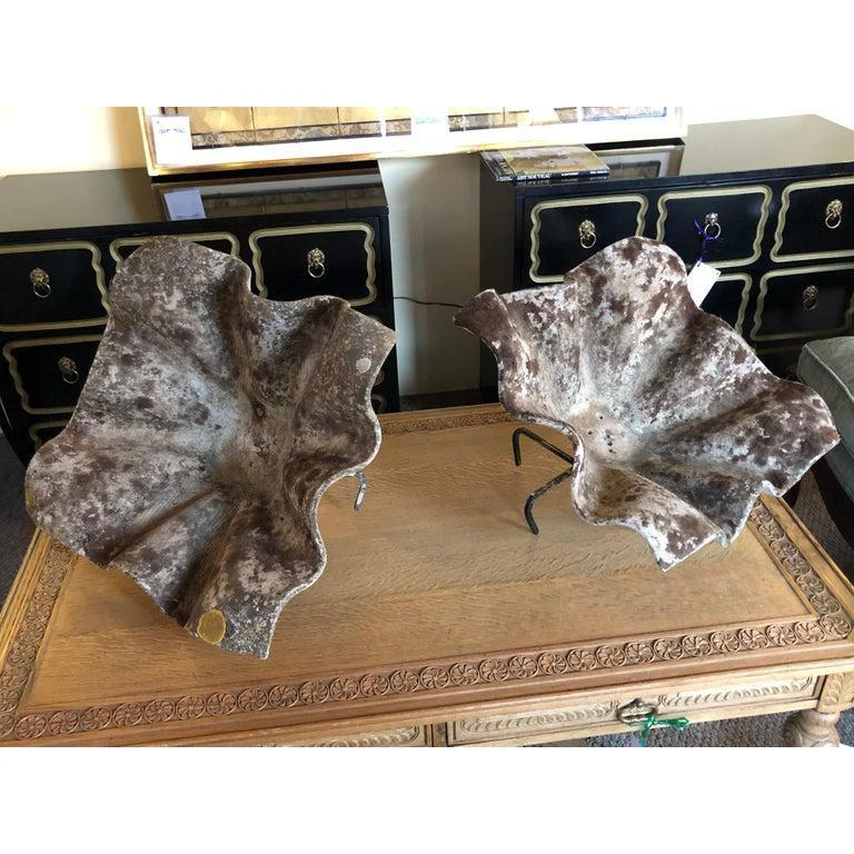 A fine pair of large and impressive Willy Guhl vintage shell or handkerchief form planters on custom metal stands. This breathtaking pair of planters can be used for fruit, floral settings, candy or the like as they create a stunning tabletop