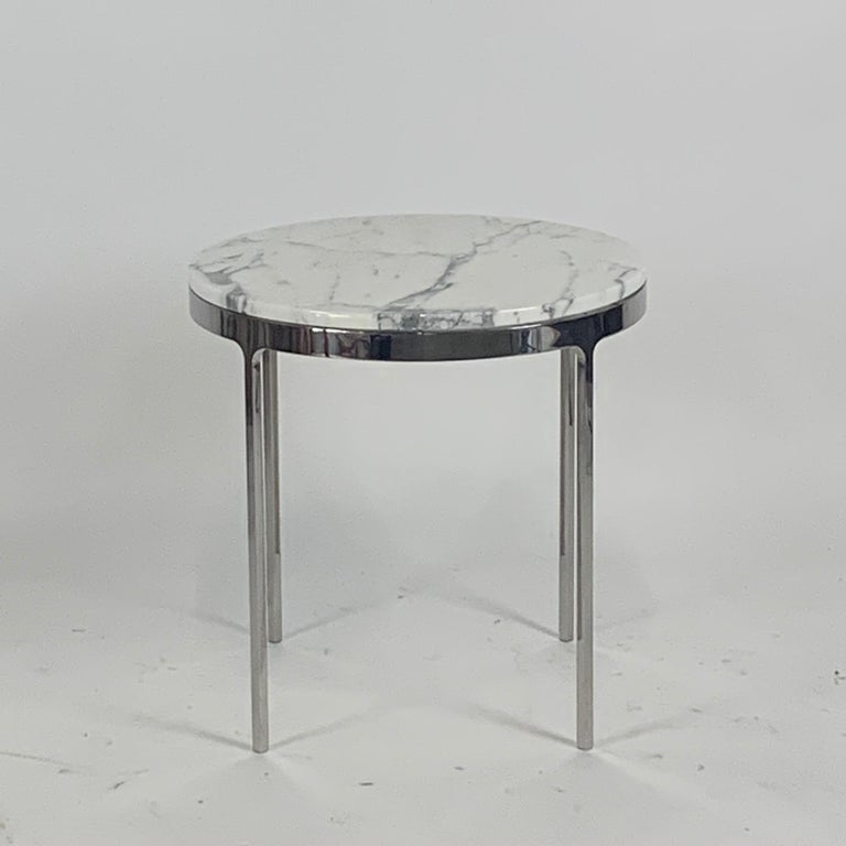 Rare generously sized pair of original Nicos Zographos marble side tables, produced by Zographos Designs Limited. The base is solid steel construction. The tops are beautiful heavy rounds of excellent marble. Measures: 24