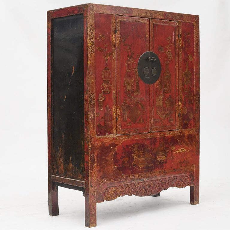 Rare set of cabinets. Red lacquer with original carvings and well-preserved leaf gold decorations. Black lacquer on the sides of the cabinet. A decorative and beautiful pair of cabinets from Shanxi Province, late 18th century.  Features two