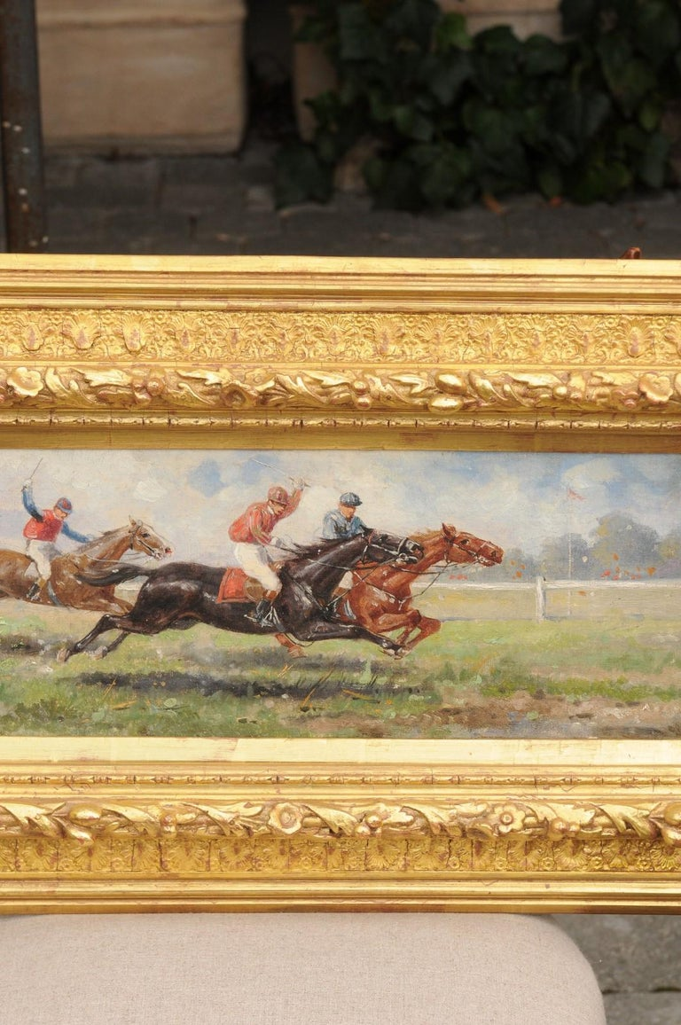 A pair of American horizontal oil on canvas paintings from the late 19th century, depicting horse races and set inside giltwood frames. Born in the later years of the 19th century, each of this exquisite pair of oil on canvas paintings features a