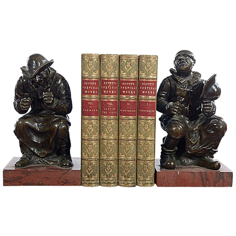 Pair of Late 19th Century Bronze Figures Each on a Rouge Marble Base For Sale