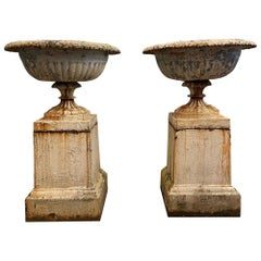 Pair of Late 19th Century Cast Iron Urns on Plinths